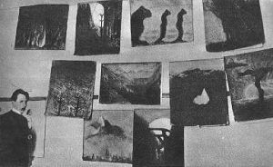 Ciurlionis at his paintings in the Warsaw School of Arts (1905)